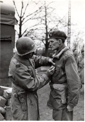 Brig Hill, wearing a Windak Air Ministry smock, being decorated with the Silver Star by Gen Ridgeway, 1945.