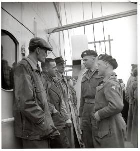 Charles Strafford (centre with hands in jacket pocket), with Brig Hill on his left, on a postwar visit to Normandy.