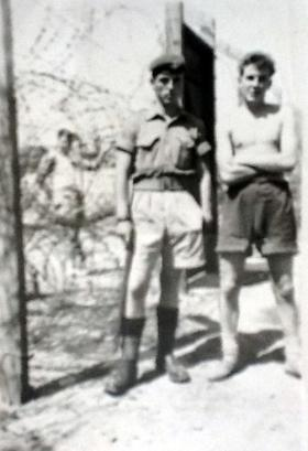 Pte Charlesworth and friend outside camp, Cyprus, summer 1956.