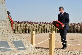 The Minister of Defence, Dr Liam Fox, lays a wreath, with 16 Air Assault soldiers in the background, Afghanistan, 2010