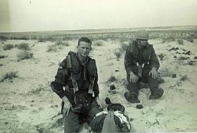 Members of 7 Para Lt Regt RHA on a Drop Zone after a jump, Trucial Oman c 1963.