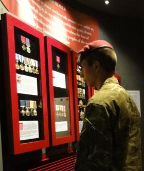 A recruit from ITC Catterick looks at the medal display at the Airborne Assault Museum, Duxford 28 May 2012.