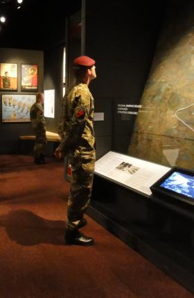 Member of 13 Air Assault looking at the Normandy model, Airborne Assault Duxford, 29 May 2012.