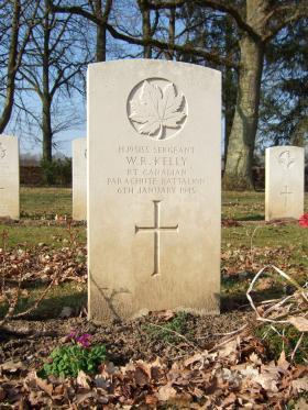Grave of Sgt Kelly, Hotton War Cemetery, Belgium, 2015.