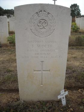 Headstone of Spr Frank Wolfe, Ranville War Cemetery, undated.