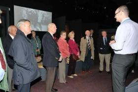 The curator gives a talk in the museum to veterans of the Duke of Lancasters Regiment, Duxford 2010