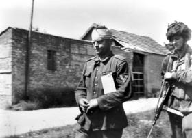 Pte Durston with a German Prisoner, June 1944.