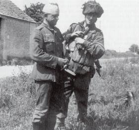 Pte Durston with a German Prisoner at the Escarde Crossroads, June 1944.