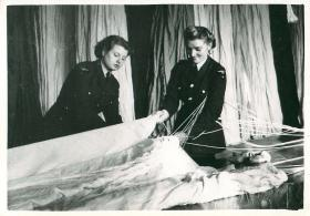 Two female parachute packers at work.