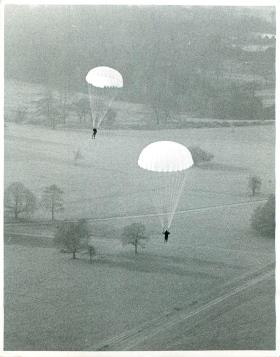 Parachute troops in air after a training jump, Tatton Park, 9 Jan 1941