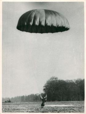 Trainee adopting the parachute position on landing, poss RAF Netheravon.