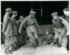 Drag training teaches trainee parachutists to release themselves from being dragged by parachute on the ground.
