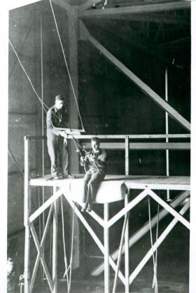 Recruit preparing to jump from a swing-style flight trainer at Ringway in 1943.