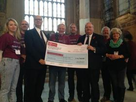 Eric Pickles presents a cheque to the Parachute Regiment Charity, October 2014.