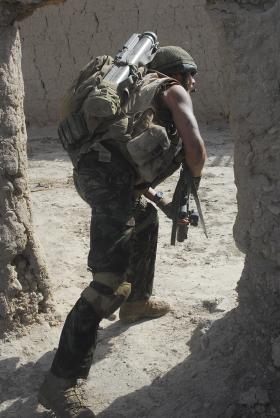 Para edges through a compound on a patrol, Afghanistan, 2008