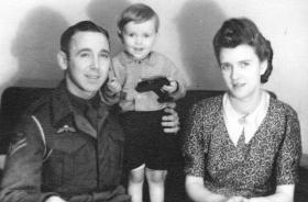 Bdr Ernest Gregory with son Michael and Edna his wife, 1946.