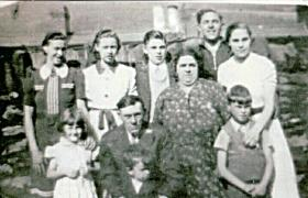 'Bobby' Evans with his Mam, Dad, brothers and sisters at the family home in Penrhiwceiber, South Wales, late 1930s