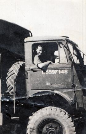 Cpl E Brown driving a truck, Palestine.