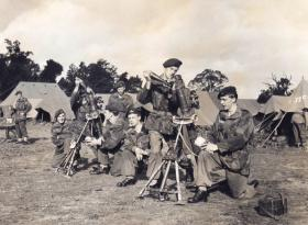 Members of 44th Parachute Brigade performing 3 inch mortar drills, Ex King's Joker, 1953
