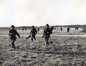 Men of 16th Airborne Division moving off DZ, Ex King's Joker, 1953