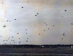 Massed descent onto Stanford Training Area by men of 44th Parachute Brigade (TA), Ex King's Joker, 1953