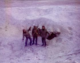 Argentine soldiers pose in a bomb crater, Stanley airfield, Falklands, 1982.