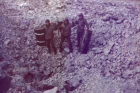 Another view of Argentine soldiers in a bomb crater, Stanley airfield, Falklands, 1982.