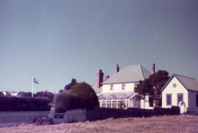 The Argentine flag flies over Government House, Falklands, 1982