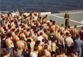 Padre Cooper holding a service, MV Norland, 1982
