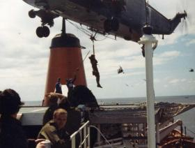 A Sea King helicopter winching personnel, MV Norland, 1982