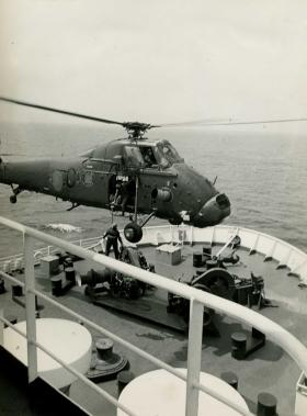 A Wessex brings orders to the MV Norland, en route to the Falklands, 1982