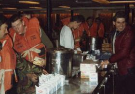 Refreshments during Life Boat Drill, MV Norland, 1982.