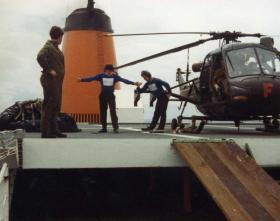 The RN Deck Crew celebrate the successful landing of the helicopter, MV Norland, 1982