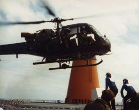 A Westland Scout helicopter lands on the MV Norland, 1982