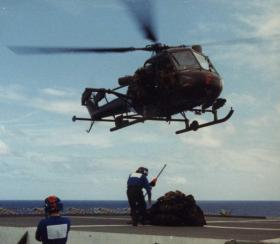 Resupply from a Scout helicopter, MV Norland, 1982