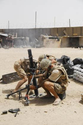 3 PARA mortar team firing an 81mm Mortar, Musa Qala, Afghanistan, August 2008.