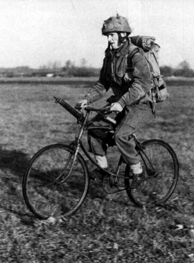 An airborne soldier on a folding bicycle, c1944.