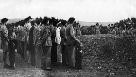 Mourners at the funeral of 2nd Parachute Battalion members, Khayat Beach War Cemetery, 1947.