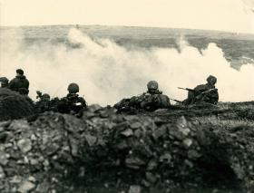 Gorse burning at Darwin. 2 PARA soldiers look on.