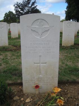 Gravestone of E S Corteil and his paradog Glen, Ranville War Cemetery