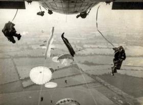 Members of 16 Para Bde Sig Sqn jumping from a Hastings, 6 December 1956.