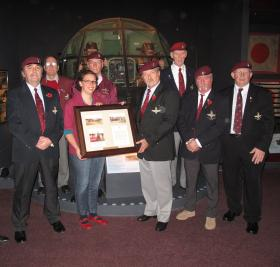 Grimsby PRA present a framed copy of the presentation of colours to the museum, 2010.