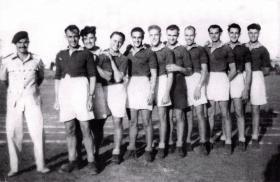 Group photograph of 716 Lt Comp Coy Tug-o-war team, Haifa, Palestine