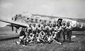 Group picture of Paras prior to emplaning a Dakota
