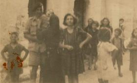 Harold 'Bill' Williams pictured with a local family and other civilians, Italy