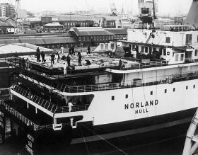 MV Norland being fitted with helipad prior to heading south on Operation Corporate, Hull, 1982.