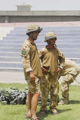 Soldiers of 3 PARA sport helmets and shorts in Kandahar, Afghanistan, June 2008