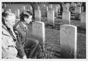 Brigadier Hill and Colonel Flood visit Major Kippin's grave, 1963.