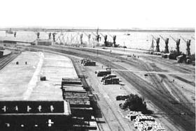 View of the dock area alongside HMIS Hindustan February 1946