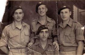 Pte Hourigan (sitting) with pals, date unknown.